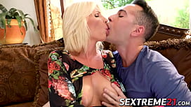 Elegant mature blonde takes young cock and cum on her face