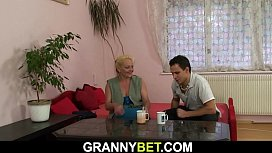 Old blonde woman enjoys riding his cock