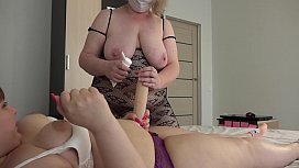 A chubby milf jumps astride a girlfriend and shakes juicy prey and big boobs. Lesbians with a huge strapon on the bed.