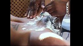 Black stud shaves hairy snatch of tattooed ebony ho then fucks it on table