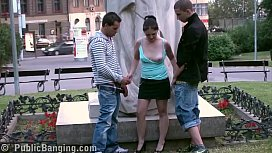A young cute girl with 2 friends public street sex threesome gangbang by a world famous statue at the central square fucking her tiny wet pussy in turn and shove their big hard cocks in her deep throat oral sexual risky adventure action