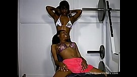 Ebony teens fuck each other with strapons