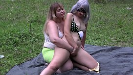 Full fisting for hairy pussy. Lesbians with big asses have fun outdoors. Fetish.