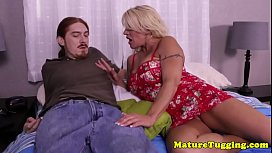 Inked busty mature loves giving handjobs