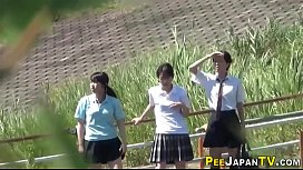 Teenage asians urinating