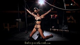 Tall slave girl hooked in suspension for pain