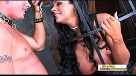 Big tit dark haired slut sucking a cock inside a cage