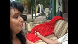 Darkhaired cougar with big boobs in red transparent outfit Ginni Lewis is ready to pay private investigator looser his hourly wages if he agrees to do her bidding