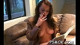 Hotty talking on the phone and playing with her shaved pussy