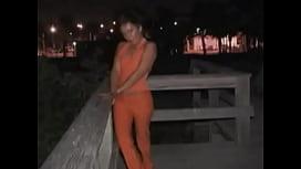 Brunette milf in orange suit fucked