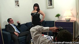 Huge titted granny swallows two cocks