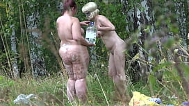 Voyeur spying on lesbians in nature. BBW with a big butt and her slender girlfriend with a hairy cunt wash in a clearing after sexual fun. Amateur fetish.