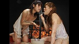 two Asian ladies having puke and enema fun