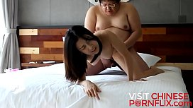 Fat slob bangs a cute Chinese girl in a hotel room