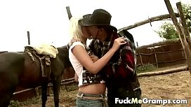 Sexy cowgirl blowing old man