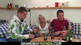 Old blonde grandma swallows two huge dicks