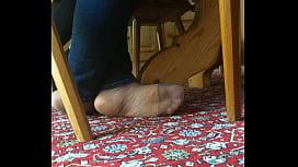 my girlfriend is resting her feet in tan nylons