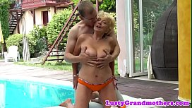 Busty grandma banged from behind outdoors