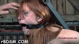 Slave has to wear a metal cage helmet  during muff torturing