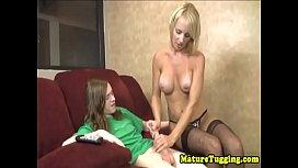 Stockinged stepmom wanking dick until cumshot