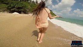 Big natural tits MILF Niemira strips on a sunny island