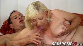 Mature blonde Irene rides young cock before facial