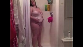 Chubby young chick getting naked in the shower