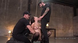 Busty slave tied up and banged in threesome
