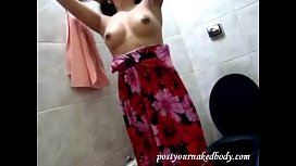 Brazilian Teen with dark nipples and a hairy virgin pussy strips in the bathroom