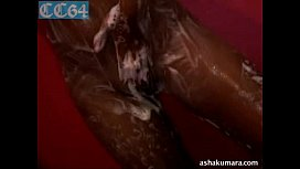 Dusky and sexy Asha Kumara stripping naked and taking shower