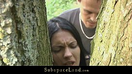 Hot brunette restrained in the woods and fucked image