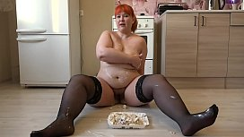 Redhead bbw with big ass loves to eat and masturbate with food, crush fetish with cake and cream on hairy pussy.