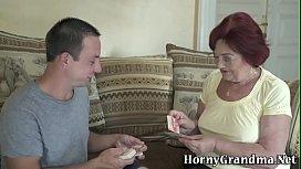 Chubby redheaded old woman sucks cock