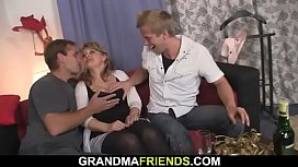 Busty milf sucks and rides at same time