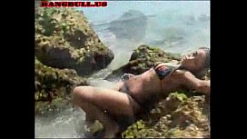 Exotic girl on the rocks