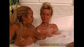 Young big boobed African babe fucks busty blonde MILF