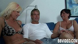 Two milfs suck and fuck a hard dick xxx video