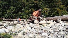 old nudist building a fire