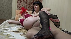 Pregnant milf masturbates with her girlfriend, petting hairy lesbians in pantyhose.