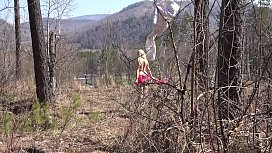Fusion with nature in the outdoors. Blonde with a big ass strips in the forest and with a bare natural hairy pussy playing with a spruce twig.