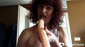 GILF sucks on her favorite sex toy