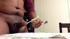 Glowstick insertion into a penis.MOV