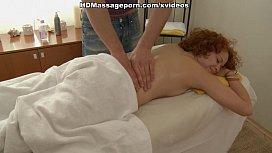 Redhead sucks balls during massage session