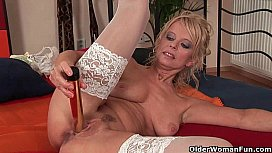 Grandma in stockings pushes a dildo up her ass