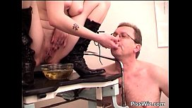 Redhead beauty pisses in a bowl and gets