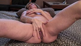 Mature Blonde SQUIRTs all over the bed!