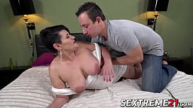 Busty mature rides a fat dick and receives cum on her face