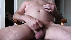 A naked daddy masturbating and cumming a load.