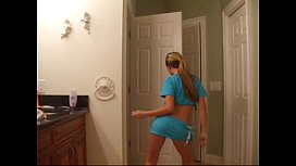 blonde babe dances and strips in the bathroom