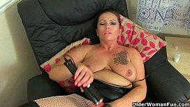 British milf Sam works her clit with a huge vibrator